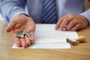 bigstock Real estate agent handing over 48438401 e1449635588412